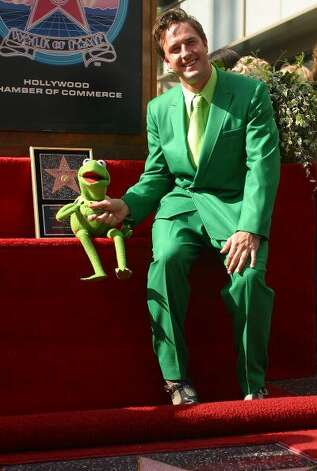 "File: World famous Muppet, Kermit the Frog, and actor David Arquette greet the public during the unveiling of a star for the amphibian icon on Hollywood's famous Walk of Fame 14 November 2002 in Hollywood, California.  Kermit has been a regular feature on the popular children's television program ""Sesame Street"". (Photo LUCIAN READ/Getty Images) (AFP/Getty Images)"