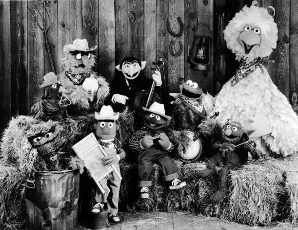 File: Publicity still of the Sesame Street Muppets taken to promote their record album, 'Sesame Country,' July 1, 1981. Included are Oscar the Crouch (in garbage can), Bert (holding washboard), Ernie (harmonica), the Count (bass), Cookie Monster (banjo), Grover (violin), and Big Bird (far right). (Photo by Children's Television Workshop/Courtesy of Getty Images) (Getty Images)