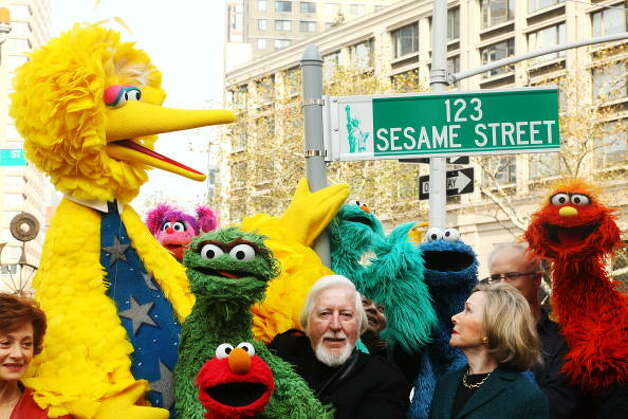 "File: (L-R) Puppeteer Caroll Spinney, Sesame Street co-founder and TV producer Joan Ganz Cooney, and Sesame Street cast members pose under a ""123 Sesame Street"" sign at the ""Sesame Street"" 40th Anniversary temporary street renaming in Dante Park on November 9, 2009 in New York City. (Photo Astrid Stawiarz/Getty Images) (Getty Images)"