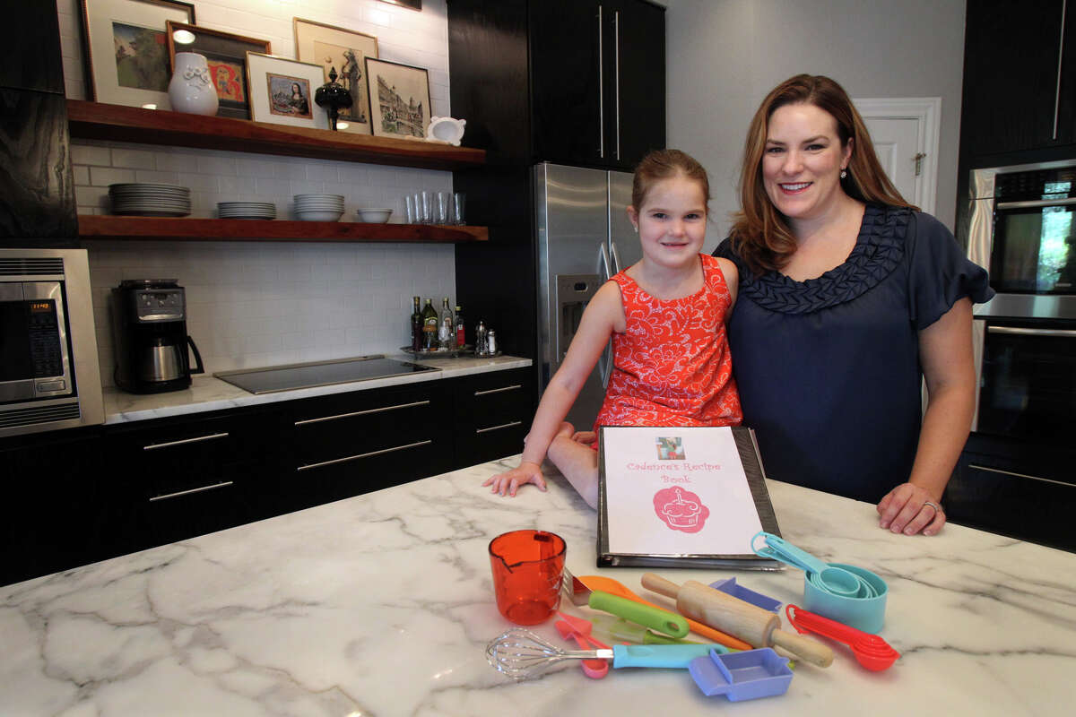 Tamara Riggan (right) loves to spend time in her kitchen with her daughter Cadence,6. Cadence even has her own recipe book.