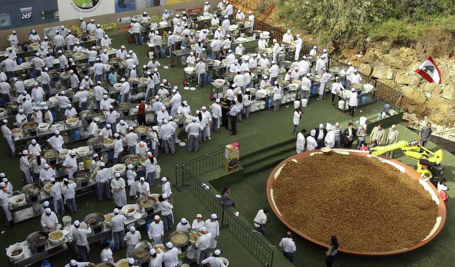 A day after regaining the world record for the largest plate of hummus, Lebanon set a new record for the largest serving of falafel on May 9, 2010 in Beirut. It weighed about 11,400 pounds. Photo: ANWAR AMRO, AFP/Getty Images