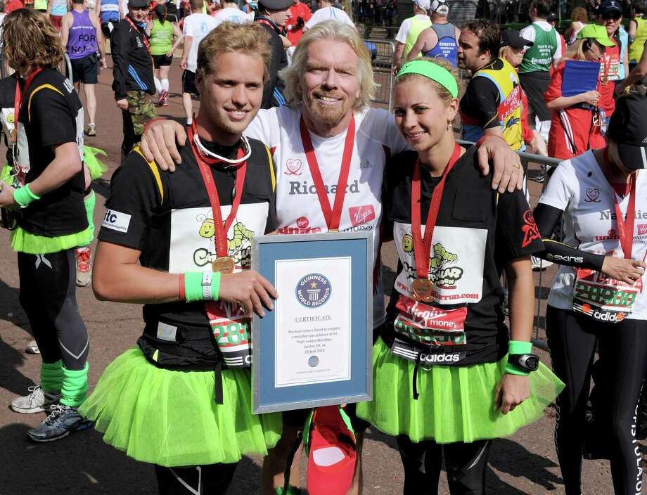 Richard Branson (center) was evidently proud of son Sam (left) and Holly (right) after they were part of a record-setting 34-person human caterpillar in the Virgin London Marathon on April 25, 2010. Photo: Gareth Cattermole, Getty Images