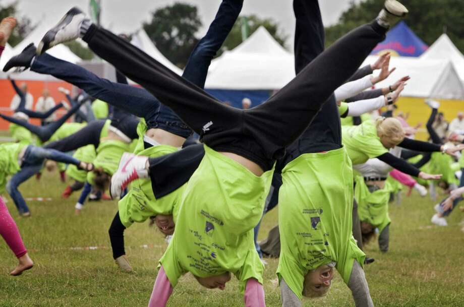 It took just 482 people to set a new cartwheel world record on July 10, 2009 at a park in Amersfoort, Netherlands. Photo: MARCEL ANTONISSE, AFP/Getty Images