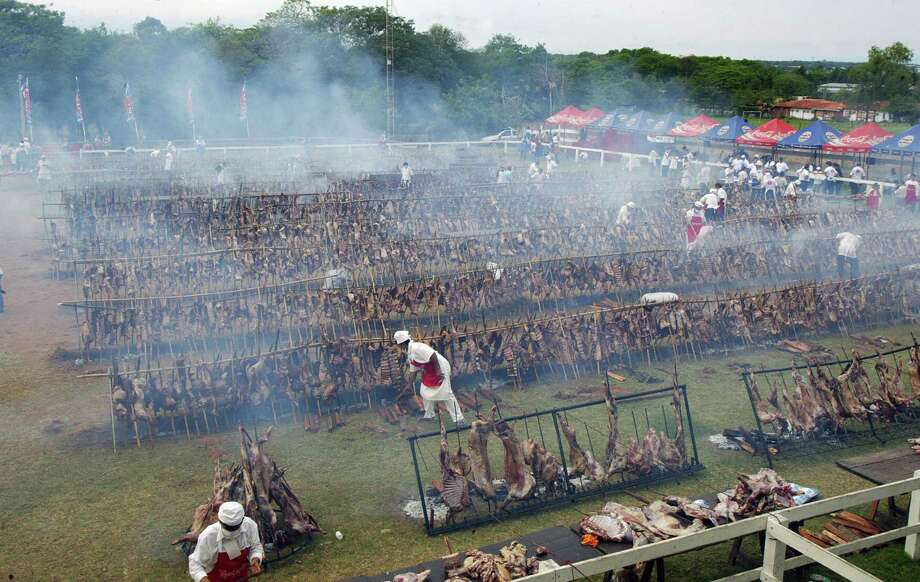"But that had nothing on the nearly 22 tons of meat barbequed during ""Todo bicho que camina va al asador"" (Every critter walking goes to the barbecue) on October 26, 2008 Mariano Roque Alonso, Paraguay. Photo: NORBERTO DUARTE, AFP/Getty Images"