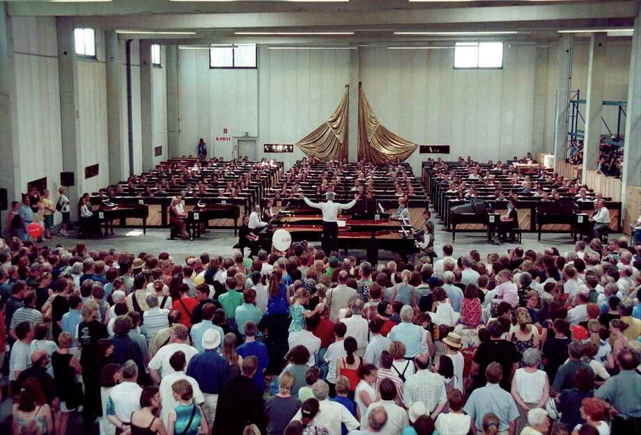 "It's a little harder to get a bunch of pianos in the same room. Here's a new record being set for the largest synchronized group piano performance on June 18, 2000 in Krefeld, Germany. They played Elgar's ""Pomp and Circumstance,"" followed by Strauss' ""Radetzky March,"" to mark the 300th anniversary of the invention of the piano. Photo: Getty Images"