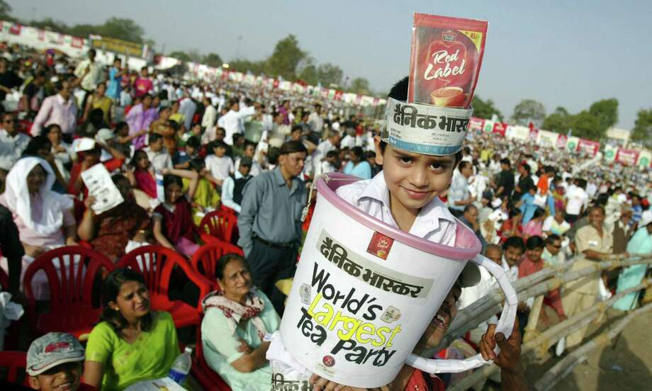 India, of course, threw the world's largest tea party, on February 24, 2008 in Indore, drawing 32,681 people, who consumed around 1,300 gallons of tea. Photo: SAJJAD HUSSAIN, AFP/Getty Images
