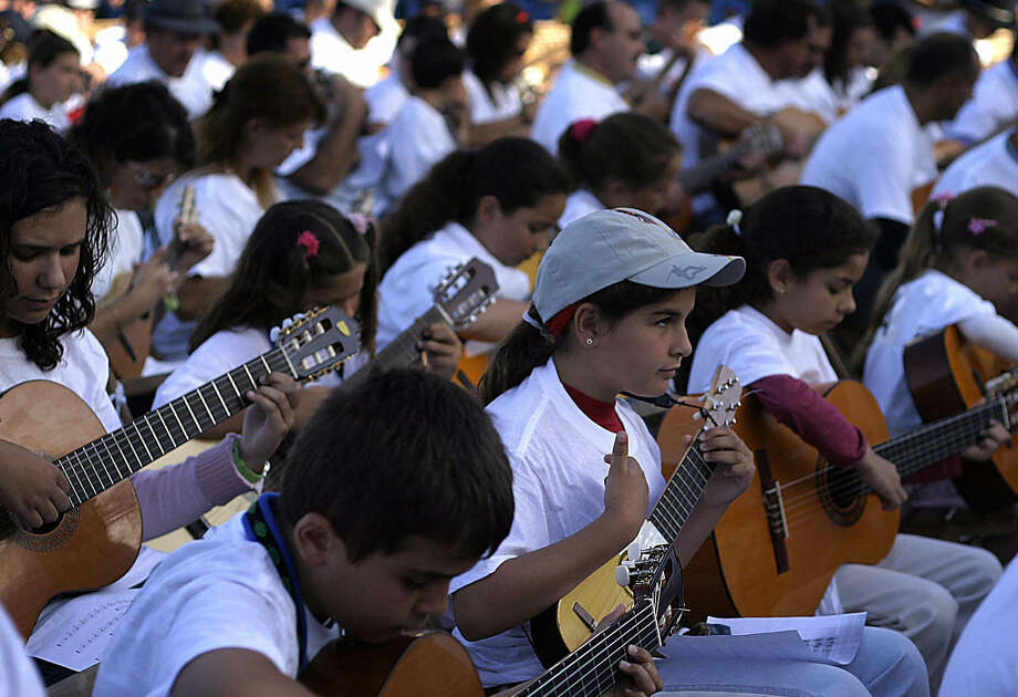 Dancing goes with music, of course. Here, hundreds gather Tenerife, Spain on April 29, 2006 to try and break a Guinness record for the number of guitar players playing the same piece of music. They're playing the timple, a guitar unique to the Canary islands. Sadly, not enough players turned up to break the record. Photo: AFP, AFP/Getty Images