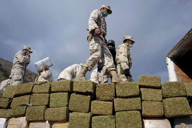 File: In this file photo Mexican soldiers unload bundles of seized marijuana before incinerating the drugs at a military base in Tijuana, Mexico, on Wednesday, Oct. 20, 2010. That week authorities had carried out the biggest marijuana bust in Mexico's history. With approximately 134 tons of marijuana headed for the U.S. were confiscated by soldiers and police. Mexico impounded more than 7,400 tons of marijuana in 2010. Photographer: David Maung/Bloomberg via Getty Images (Bloomberg via Getty Images)