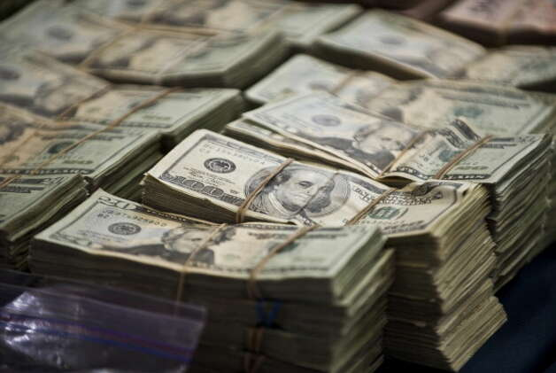 File: In this file photo, more than a million in U.S. dollars and and more than 41 million Mexican pesos were seized from the Zetas drug cartel. June 15, 2012.  (Photo Ronaldo Schemidt/AFP/GettyImages) (AFP/Getty Images)