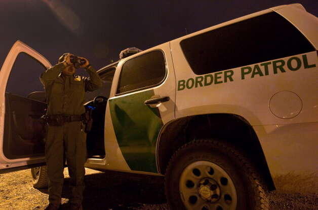 File: A member of the US Customs and Border Protection searches for illegal immigrants in El Paso, Texas, on April 6, 2011. Security in the border with Mexico has been tightened due to the soaring drug-related violence over control of lucrative drug smuggling routes into the United States. (Photo Jesus Alcazar/Getty Images) (AFP/Getty Images)