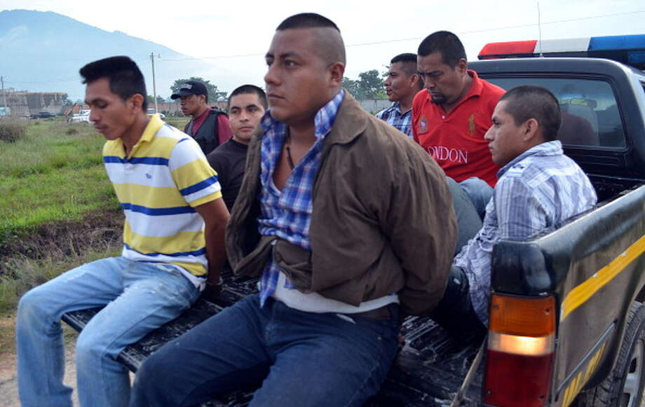 File: In this file photo taken June 1, 2012, six of the seven alleged members of the drug gang Los Zetas who were arrested in Jalapa, remain on a truck. (Photo STR/GettyImages) (AFP/Getty Images)