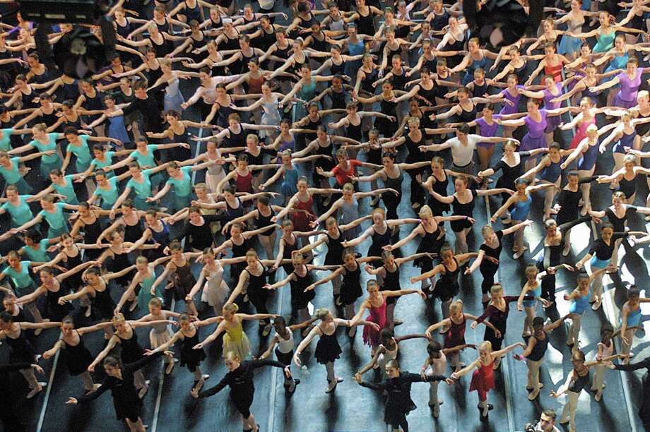 This world's largest ballet class record attempt drew 530 dancers to Canal Walk in Cape Town, South Africa, on October 12, 2003. Photo: ANNA ZIEMINSKI, AFP/Getty Images / k