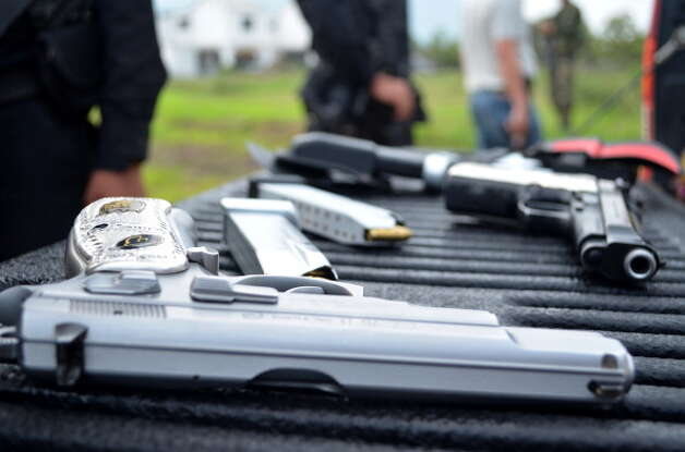 File: In this file photo a close-up view of weapons shown by police from seven alleged members of the drug gang Los Zetas arrested in Jalapa, on June 1, 2012. Guatemalan security forces had captured seven alleged members of the Mexican cartel Los Zetas. (Photo STR/GettyImages) (AFP/Getty Images)