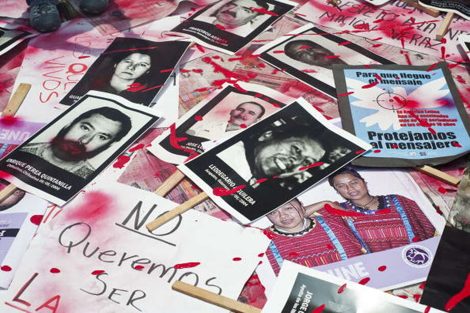 File: Mexican journalists protest against violence towards journalists in Mexico placing  on the ground pictures of murdered journalists, on August 7, 2010 in Mexico City. The protest was triggered by the abduction of four journalists. (Photo /AFP/Getty Images) (AFP/Getty Images)