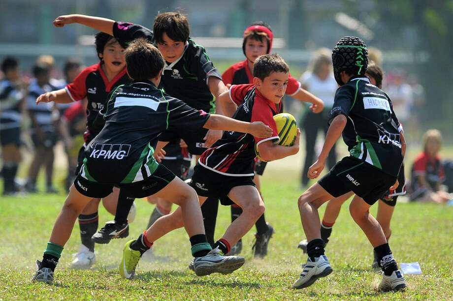 This world's largest mini rugby tournament in Hong Kong on October 30, 2010 drew around 3,000 participants aged four to 12, who made up 262 teams, playing 410 games. Photo: ED JONES, AFP/Getty Images / k