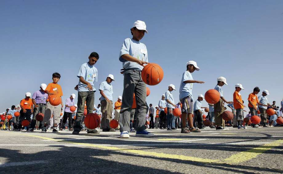 Palestinians seem to have a particular passion for world record attempts. Here, Palestinian children attempt to break the record for simultaneous basketball dribbling in the southern Gaza Strip town of Rafah on July 22, 2010. Photo: SAID KHATIB, AFP/Getty Images / k