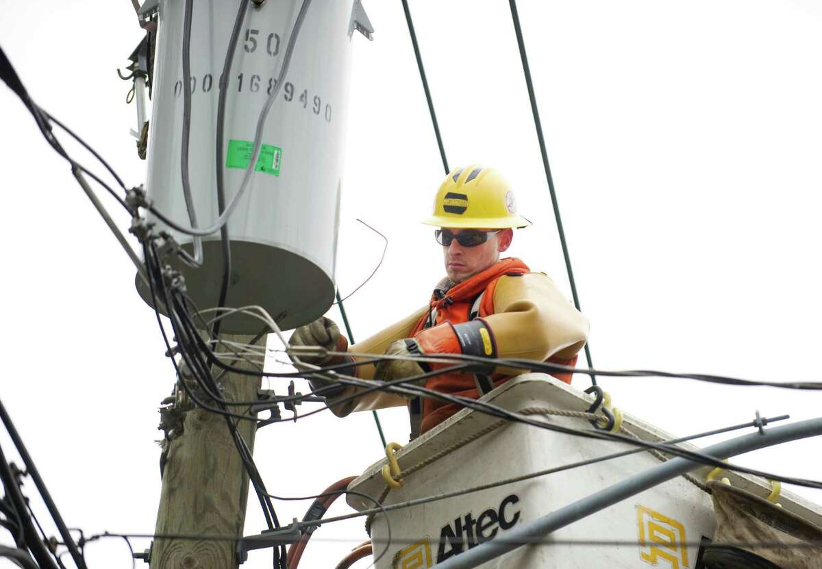 Matt Hand, of Torrington, a lineman for Asplundh, a CL&P contractor, repairs a transformer on Hubbard Ave. in Stamford, Conn. on Monday, March 15, 2010.