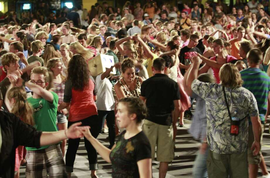 The Grand Rapids Original Swing Society on Tuesday attempted to break the Guinness World Record for swing dancing in unison at Rosa Parks Circle in downtown Grand Rapids, Mich. That got us wondering about other group world record attempts. We found some good ones. Photo: AP