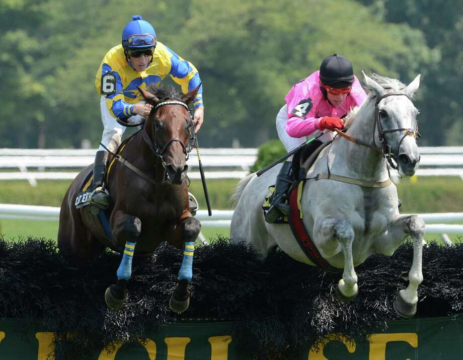 #6 Cat Feathers with jockey Bernard Dalton in the saddle jumps the last fence of The Mrs. Ogden Phipps Stakes and will move ahead to the win over #4 Sweet Shani with jockey Brian Crowley at the Saratoga Race Course in Saratoga Springs, N.Y. August 9, 2012.     (Skip Dickstein/Times Union) Photo: Skip Dickstein