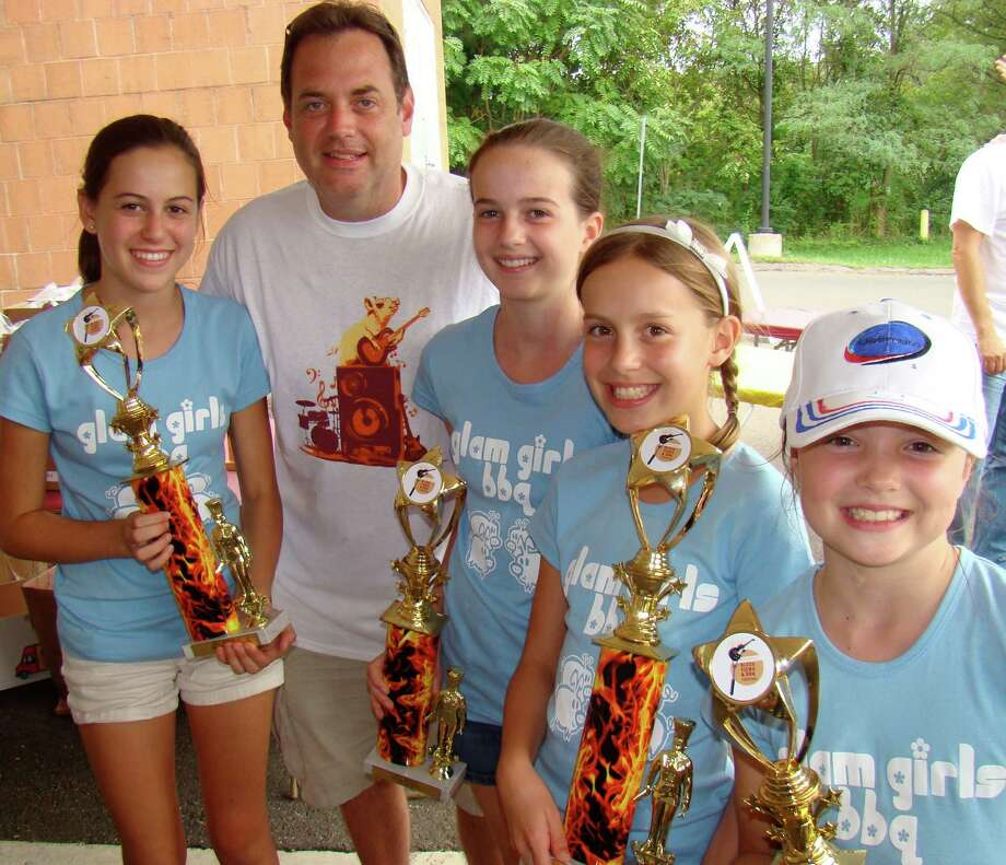 "The ìGlam Girlsî BBQ team took home the ""Kids Q"" trophy at last year's Blues, Views & BBQ Festival. This year's festival is set for Saturday, Sept. 1, and Sunday, Sept. 2. Photo: Contributed Photo"