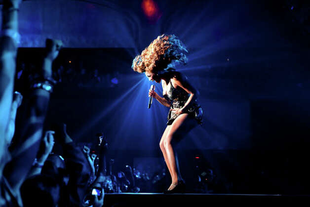 "A photograph of Beyonce during a live concert by Greenwich photographer Susannah Benjamin was featured on the back cover of the singer's ""4 Intimate Nights with Beyoncé"" concert DVD. Photo: Contributed Photo"