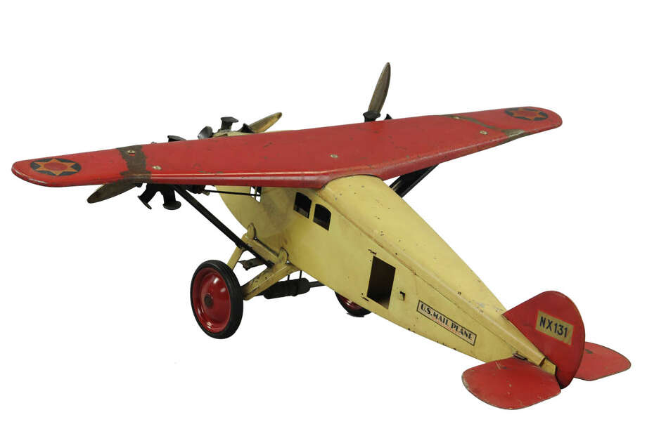 This large pressed-steel toy airplane has a 26 1/2-inch wingspan. It was made in about 1919. The tri-motor with a ìU.S. Mailî logo is marked ìSteelcraft.î It sold for $881 at Bertoia Auctions in Vineland, N.J. Photo: Contributed Photo / The News-Times Contributed