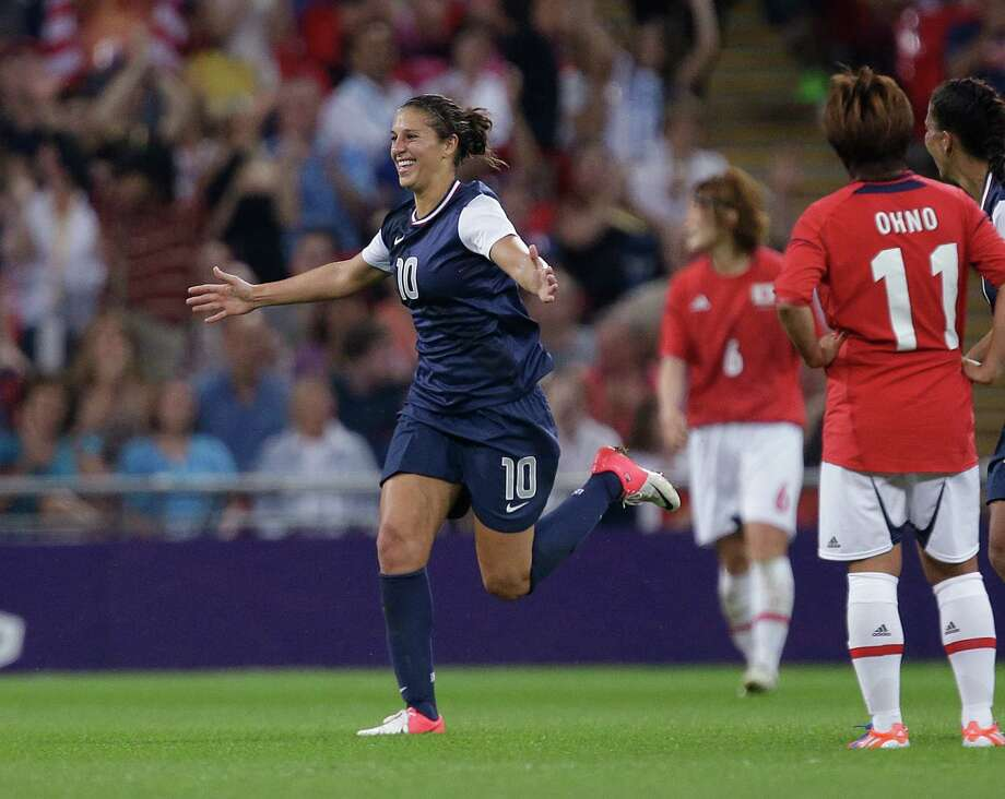 United States' Carli Lloyd (10) celebrates her goal in front of Japan's Shinobu Ohno while celebrating a goal during the women's soccer gold medal match at the 2012 Summer Olympics, Thursday, Aug. 9, 2012, in London. (AP Photo/Julie Jacobson) Photo: Julie Jacobson, Associated Press / AP