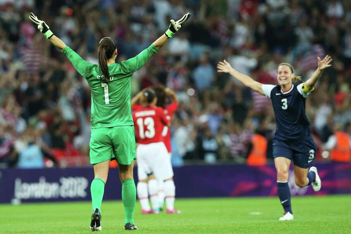 Hope Soloand Christie Rampone of the United States celebrate after defeating Japan by a score of 2-1. (Photo by Ronald Martinez/Getty Images)
