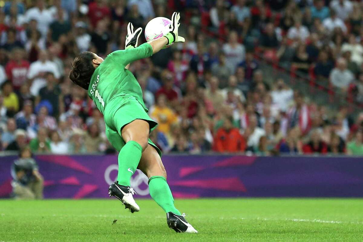 Goalkeeper Hope Solo of United States makes a save in the first half. (Photo by Ronald Martinez/Getty Images)