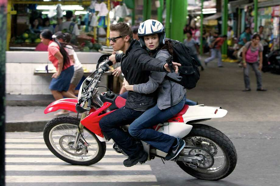 """This film image released by Universal Pictures shows Rachel Weisz as Dr. Marta Shearing, right, and Jeremy Renner as Aaron Cross in a scene from """"The Bourne Legacy."""" (AP Photo/Universal Pictures, Mary Cybulski) Photo: Mary Cybulski / Universal Pictures"""