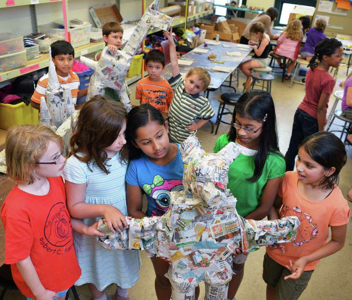 Summer arts campers paper mache sculptures at the Arts Center of the Capital Region in Troy Wednesday July 25, 2012. (John Carl D'Annibale / Times Union)