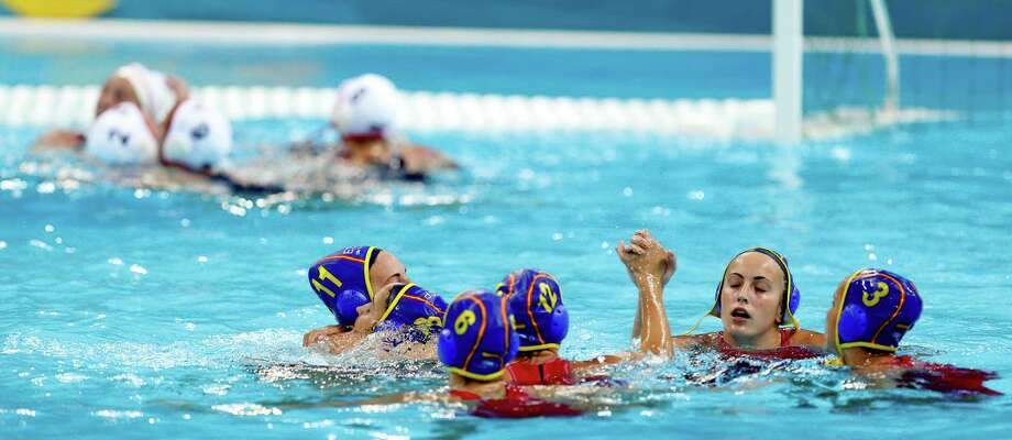 Spain women's water polo players react after the United States beat them 8-5 during the gold medal women's water polo match at the 2012 Summer Olympics, Thursday, Aug. 9, 2012, in London. (AP Photo/Julio Cortez) Photo: Julio Cortez, Associated Press / AP