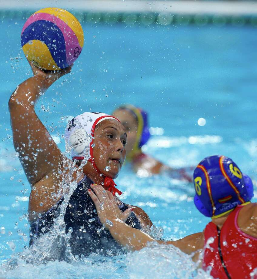 Brenda Villa of the United States shoots at goal during their women's water polo gold medal match against Spain at the 2012 Summer Olympics, Thursday, Aug. 9, 2012, in London. (AP Photo/Alastair Grant) Photo: Alastair Grant, Associated Press / AP
