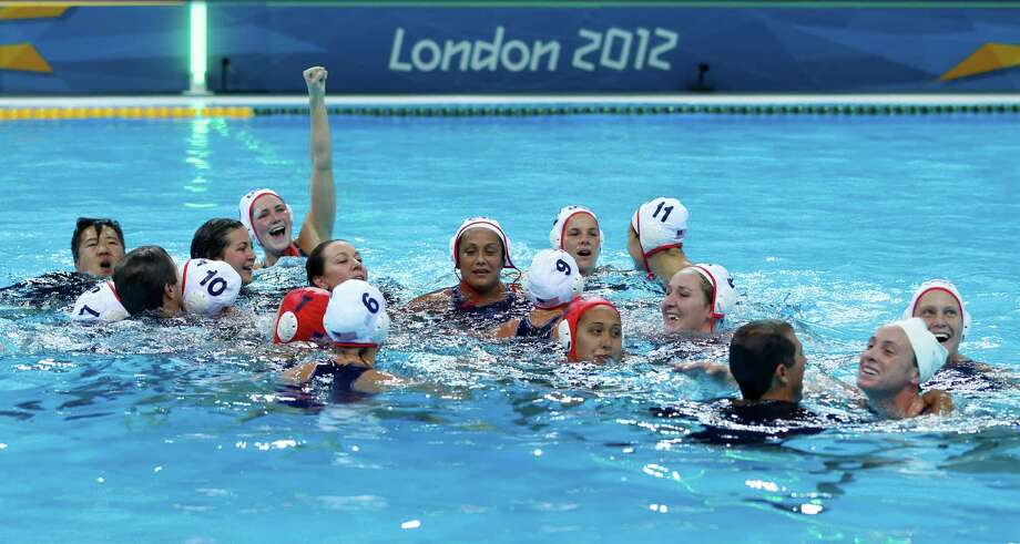 Members of the United States women's water polo team celebrate after winning the gold medal match against Spain at the 2012 Summer Olympics, Thursday, Aug. 9, 2012, in London. (AP Photo/Alastair Grant) Photo: Alastair Grant, Associated Press / AP