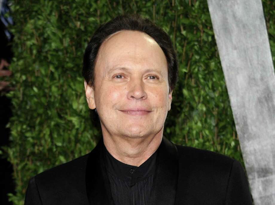 FILE - This Feb. 26, 2012 file photo shows Billy Crystal arriving at the Vanity Fair Oscar party in West Hollywood, Calif. Crystal has an agreement with Henry Holt and Company for a book that will be part memoir, part meditation _ with jokes _ about getting older. The book is currently untitled, and Crystal hopes to have it out when the big day arrives, March 14, 2013.  (AP Photo/Evan Agostini, file) Photo: Evan Agostini