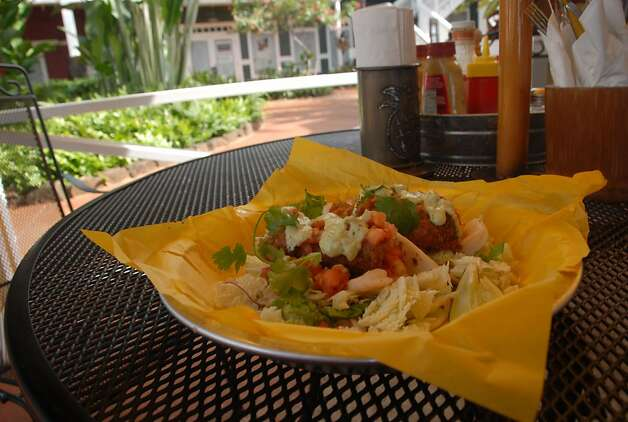 Mahi mahi, the main ingredient in the island-style fish tacos at Merriman's Downstairs Cafe on Kauai, is abundant in Hawaiian waters, but goes through periodic breeding cycles that can make it much more expensive — which contributes to its sustainability in the islands. Photo: Jeanne Cooper, Special To SFGate