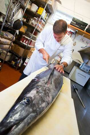 Chef Peter Merriman fillets a locally caught ono, the Hawaiian name for wahoo. His latest culinary venture, Monkeypod Kitchen in Wailea, Maui, is offering sustainable seafood specials in conjunction with the Hawaii Fish Trust. Photo: Merriman's