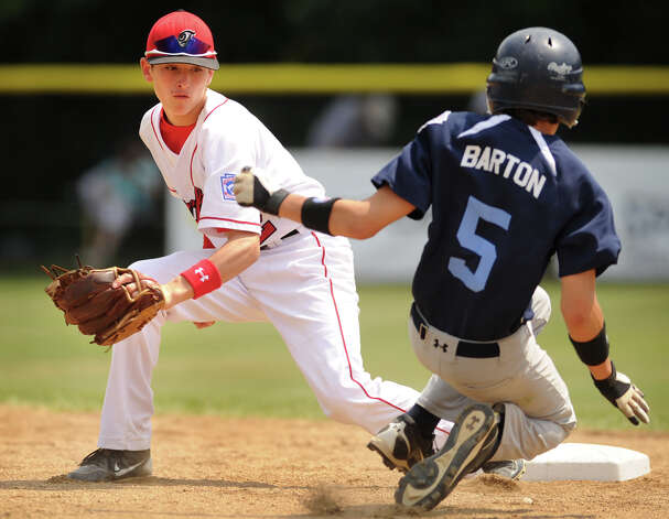 Fairfield American's Will Lucas prepares to apply the tag as Vermont's Noah Barton is caught stealing second  in the third inning of their 2012 Little League Eastern Regional game in Bristol on Thursday, August 9, 2012. Fairfield American won the game 4-3 in eight innings. Photo: Brian A. Pounds / Connecticut Post