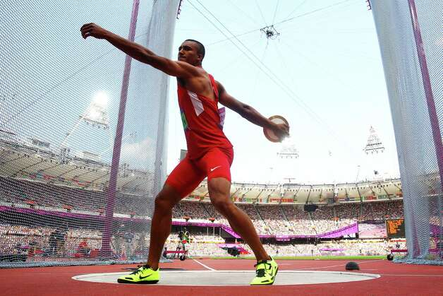LONDON, ENGLAND - AUGUST 09:  Ashton Eaton of the United States competes during the Men's Decathlon Discus Throw on Day 13 of the London 2012 Olympic Games at Olympic Stadium on August 9, 2012 in London, England. Photo: Alexander Hassenstein, Getty Images / 2012 Getty Images