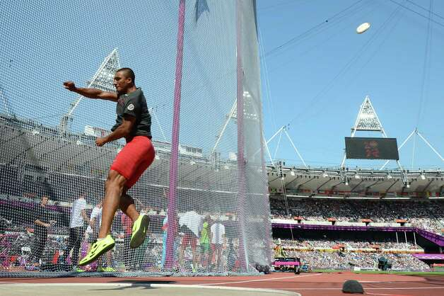 US' Ashton Eaton competes in the men's decathlon discus throw at the athletics event during the London 2012 Olympic Games on August 9, 2012 in London. AFP PHOTO / FRANCK FIFEFRANCK FIFE/AFP/GettyImages Photo: FRANCK FIFE, AFP/Getty Images / AFP