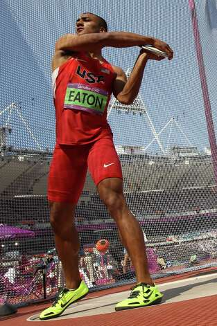 US' Ashton Eaton competes in the men's decathlon discus throw at the athletics event during the London 2012 Olympic Games on August 9, 2012 in London.  AFP PHOTO / ADRIAN DENNISADRIAN DENNIS/AFP/GettyImages Photo: ADRIAN DENNIS, AFP/Getty Images / AFP