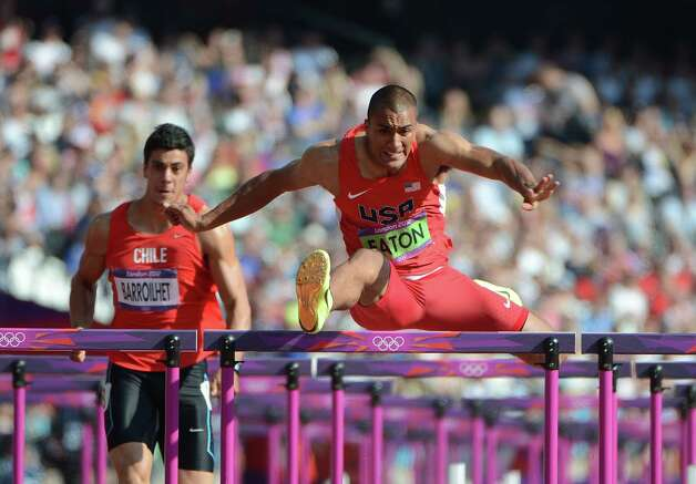 US' Ashton Eaton (R) and Chile's Gonzalo Barroilhet compete in the men's decathlon 110m hurdles heats at the athletics event during the London 2012 Olympic Games on August 9, 2012 in London.  AFP PHOTO / OLIVIER MORINOLIVIER MORIN/AFP/GettyImages Photo: OLIVIER MORIN, AFP/Getty Images / AFP