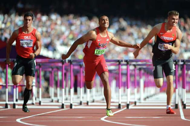 US' Ashton Eaton (C), Chile's Gonzalo Barroilhet (L) and Germany's Rico Freimuth compete in the men's decathlon 110m hurdles heats at the athletics event during the London 2012 Olympic Games on August 9, 2012 in London.  AFP PHOTO / OLIVIER MORINOLIVIER MORIN/AFP/GettyImages Photo: OLIVIER MORIN, AFP/Getty Images / AFP