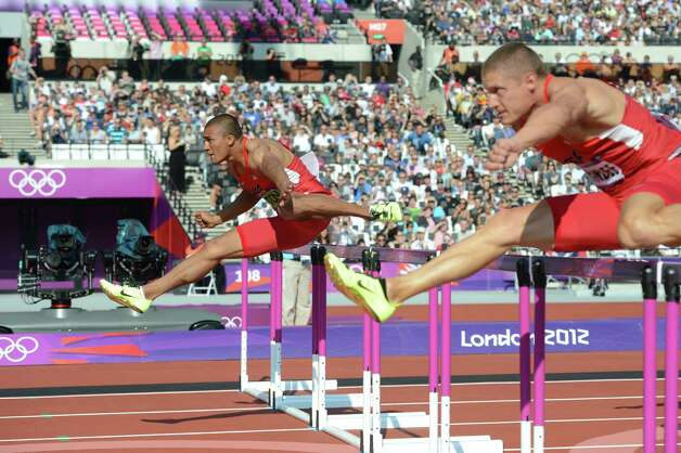 US' Ashton Eaton (L) and US's Trey Hardee compete in the men's decathlon 110m hurdles heats at the athletics event during the London 2012 Olympic Games on August 9, 2012 in London.  AFP PHOTO / FRANCK FIFEFRANCK FIFE/AFP/GettyImages Photo: FRANCK FIFE, AFP/Getty Images / AFP