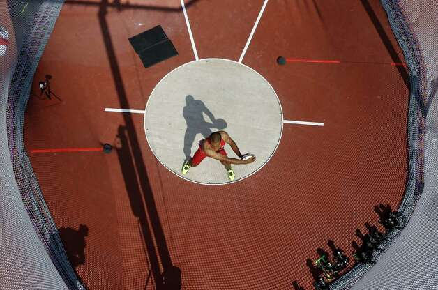 US' Ashton Eaton competes in the men's decathlon discus throw event at the London 2012 Olympic Games at the Olympic Stadium on August 9, 2012.    AFP PHOTO / POOL / PAWEL KOPCZYNSKIPAWEL KOPCZYNSKI/AFP/GettyImages Photo: PAWEL KOPCZYNSKI, AFP/Getty Images / AFP