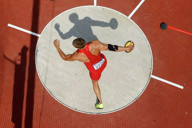 US' Trey Hardee competes in the men's decathlon discus throw qualifying rounds at the athletics event during the London 2012 Olympic Games on August 9, 2012 in London. AFP PHOTO / POOL / PAWEL KOPCZYNSKIPAWEL KOPCZYNSKI/AFP/GettyImages Photo: PAWEL KOPCZYNSKI, AFP/Getty Images / AFP