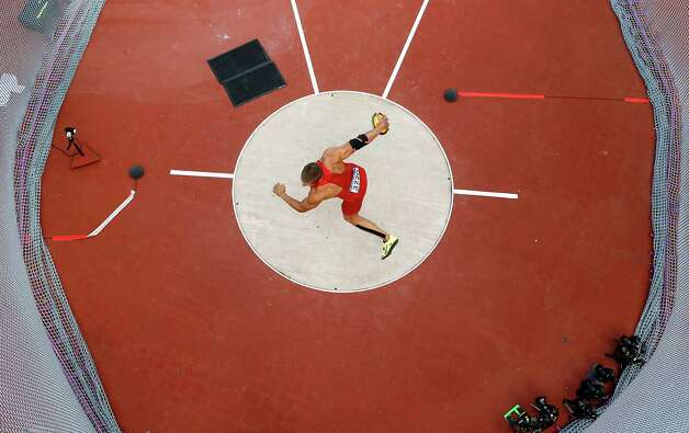US's Trey Hardee competes in the men's decathlon discus throw event of the London 2012 Olympic Games at the Olympic Stadium on August 9, 2012.    AFP PHOTO / POOL - PAWEL KOPCZYNSKIPAWEL KOPCZYNSKI/AFP/GettyImages Photo: PAWEL KOPCZYNSKI, AFP/Getty Images / AFP
