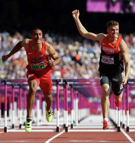 United States' Ashton Eaton, left, and Germany's Rico Freimuth go to cross the finish line in a 110-meter hurdles heat in the decathlon during the athletics in the Olympic Stadium at the 2012 Summer Olympics, London, Thursday, Aug. 9, 2012. (AP Photo/Anja Niedringhaus) Photo: Anja Niedringhaus, Associated Press / AP