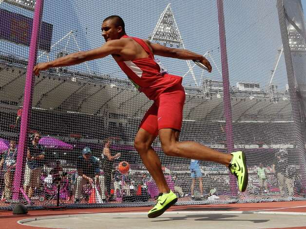 United States' Ashton Eaton takes a throw in the discus throw decathlon during the athletics in the Olympic Stadium at the 2012 Summer Olympics, London, Thursday, Aug. 9, 2012. (AP Photo/David J. Phillip) Photo: David J. Phillip, Associated Press / AP