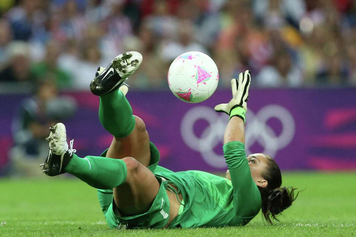 Goalkeeper Hope Solo makes a save against Japan Thursday.